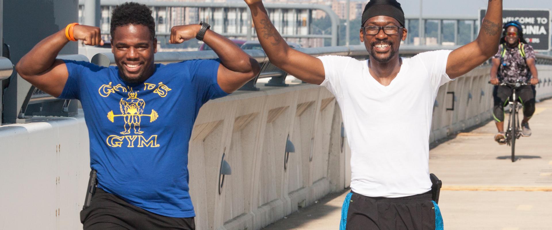Men Walking in Celebration on Wilson Bridge